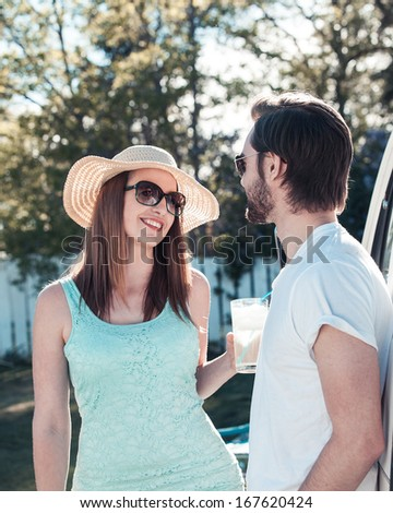 Young attractive couple in the summer - stock photo