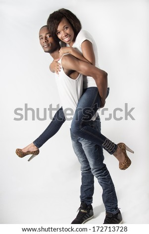 Young Attractive Couple piggy back_ - stock photo
