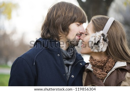Young attractive couple together outdoors - stock photo
