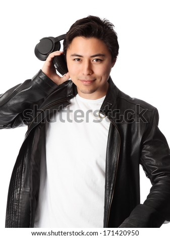 Young attractive DJ wearing headphones and a black leather jacket. White background. - stock photo