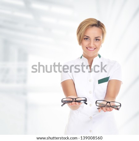 Young attractive doctor isolated over the abstract hospital background - stock photo