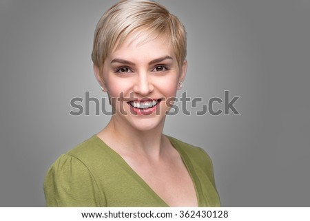Young attractive edgy fashionable modern look young refreshing headshot short pixie hair perfect smile teeth  - stock photo