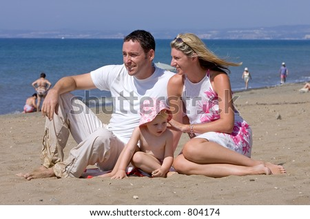 Young attractive family on beach vacation in Spain on the Costa del Sol on a sunny day