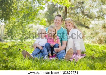 Young Attractive Family Portrait Enjoying the Park.