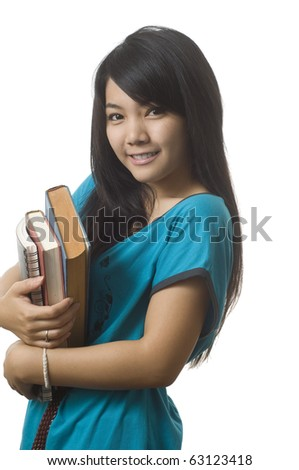 Young attractive female Asian student holding her school books