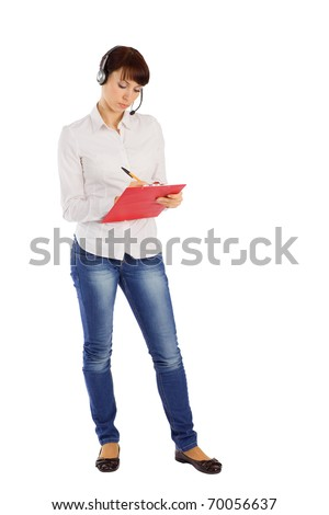 Young attractive female customer service representative with headset writing on clipboard, standing on isolated white background - stock photo