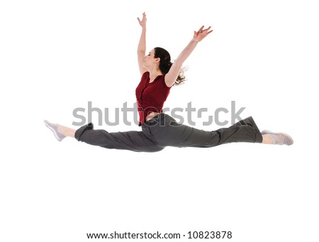 young attractive female dancer doing the splits - stock photo