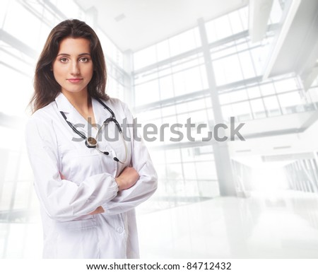Young attractive female doctor isolated over white background - stock photo