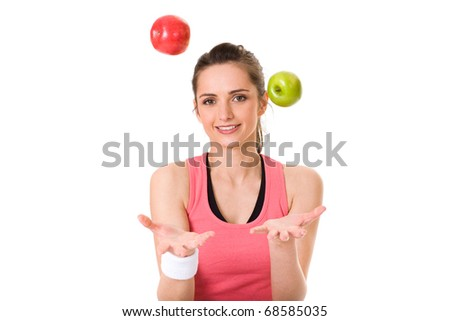 young attractive female in fitness top, with green and red apple, studio shoot isolated on white - stock photo