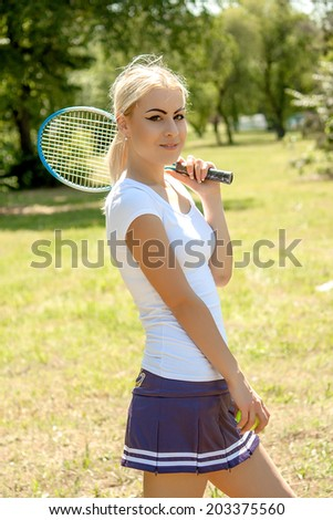 young attractive female tennis player - stock photo