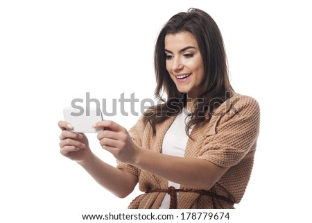 Young attractive female using mobile phone   - stock photo