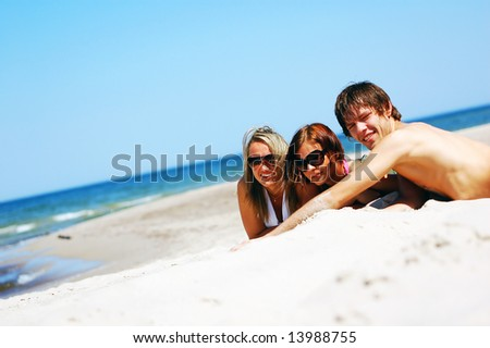 Young attractive friends enjoying together the summer beach