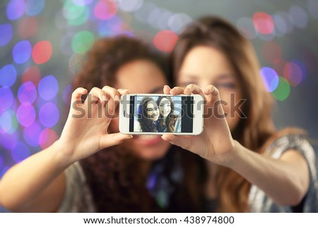 Young attractive friends taking selfie, close up - stock photo