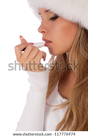 Young attractive girl applauding balsam for lips, care of her lips. Isolated on white background - stock photo