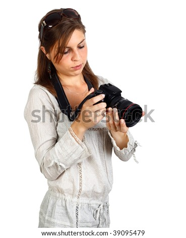 Young attractive girl checking her camera