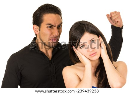 young attractive girl covering ears from angry screaming husband boyfriend isolated on white