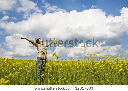 Young attractive girl enjoying spring