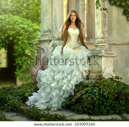 Young attractive girl .Fairy tale with princess in old medieval  garden. - stock photo