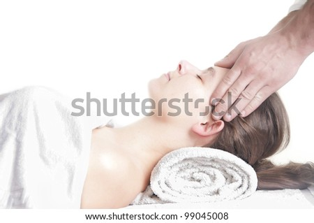Young attractive girl having head massage at spa resort