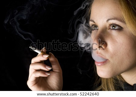 Young attractive girl holding a cigarette