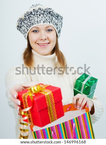 young attractive girl in a sweater holding a gift - stock photo