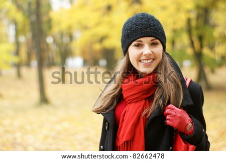 Young attractive girl in autumn park - stock photo