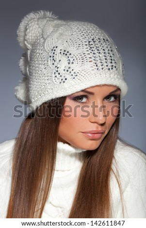 Young attractive girl in warm winter clothes. Studio shot