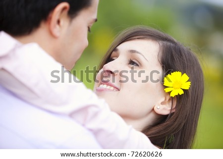 Young attractive girl looking at her boyfriend - stock photo
