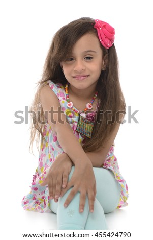 Young Attractive Girl Sitting With Beautiful Smile Isolated on White Background - stock photo