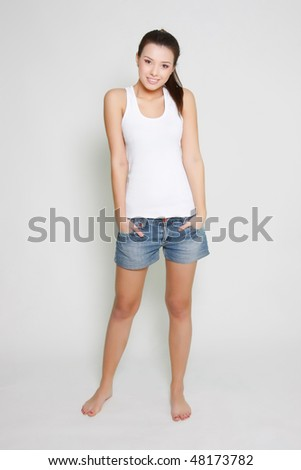 young attractive girl standing over white - stock photo
