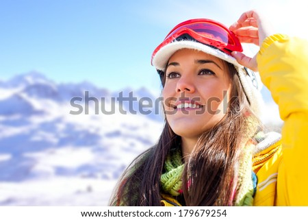 Young attractive girl wearing goggles and anorak ready for winter sport. - stock photo