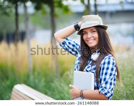 Young attractive girl with a laptop