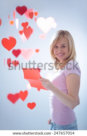 Young attractive girl with a letter and hearts - stock photo
