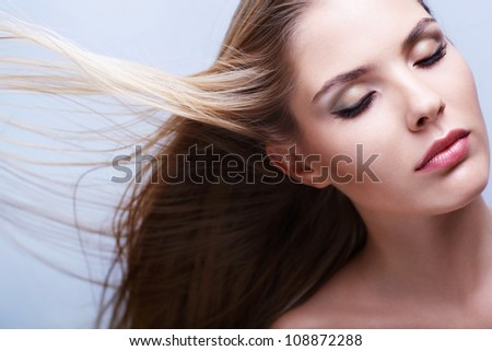 Young attractive girl with flying hair - stock photo