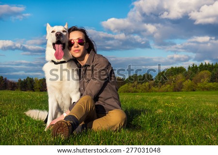 Young attractive girl with her pet dog - stock photo