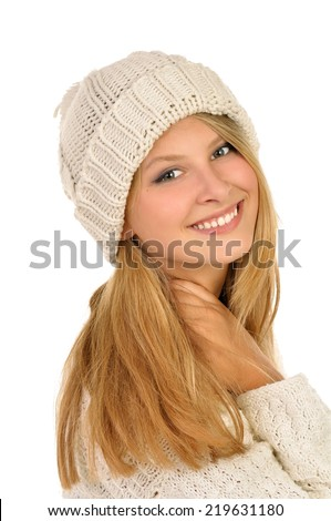 Young attractive girl with woolen hat in the studio . - stock photo