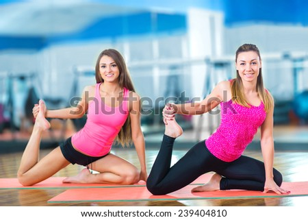 Young attractive girls do yoga. - stock photo