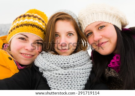 Young  attractive girls selfie outdoors in winter. - stock photo