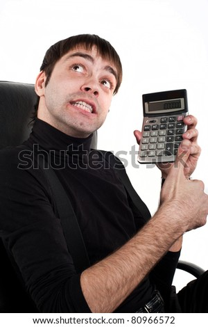 young attractive guy in the black businessman Caucasian  sits on a black leather chair and holding a  cost accountant ,the calculator shows the camera and performs calculations.isolated over white