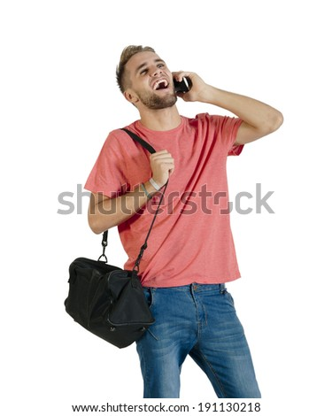 Young attractive guy laughing on mobile phone - stock photo