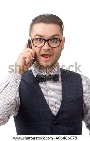 Young attractive guy talking on the phone isolated on white