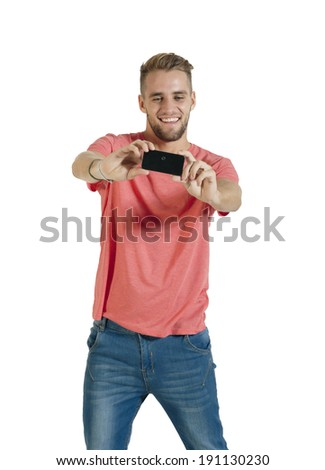 Young attractive guy using mobile phone - stock photo