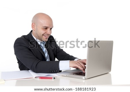 young attractive happy bald latin american business man smiling and working on computer at office desk isolated on white background