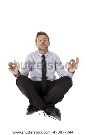 young attractive happy businessman relaxing with hands in yoga position looking cheerful friendly wearing shirt and necktie isolated in white background sitting on the floor in relax at work concept