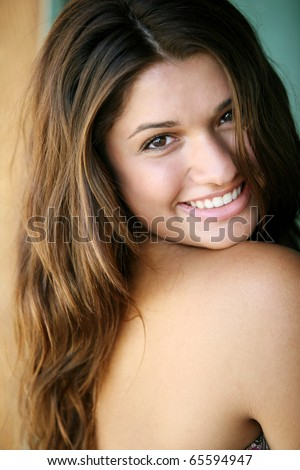 Young attractive happy girl enjoys summer day. - stock photo