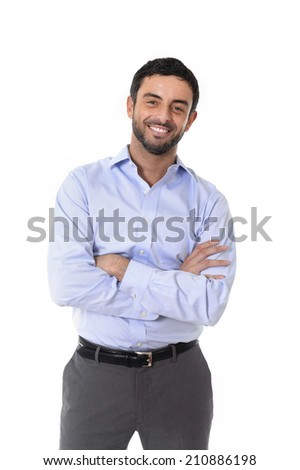 young attractive happy latin business man standing in corporate portrait isolated on white background smiling with folded arms in shirt and suit trousers - stock photo