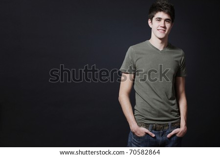 Young attractive happy man possing in studio. - stock photo