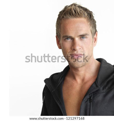 Young attractive healthy man against white background with copy space - stock photo