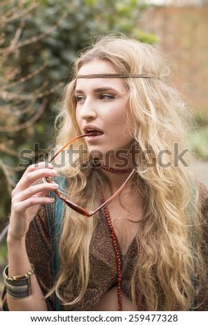 young attractive hippie woman posing in garden - stock photo