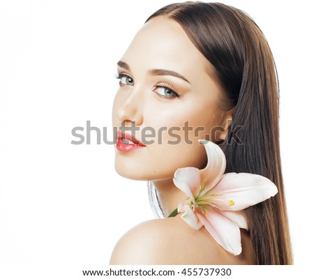 young attractive lady close up with hands on face isolated flower lily brunette spa nude makeup - stock photo